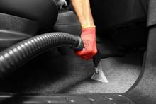 Male Worker Using Vacuum Clean...