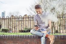 Man Smoking Electronic Cigaret...