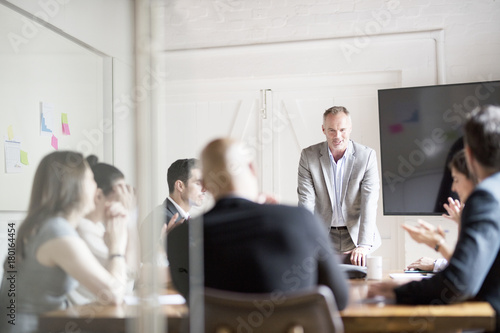 Mature businessman talking during meeting in office conference room