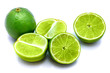 Group of sliced lime halves and one whole isolated on white studio background.