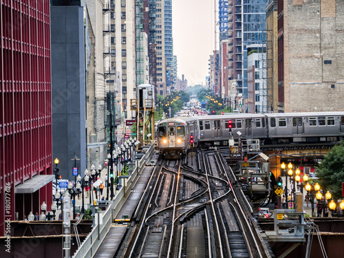 Poster Chicago Elevated Train Tracks above the streets and between buildings at The Loop August 3rd, 2017 - Chicago, Illinois, USA