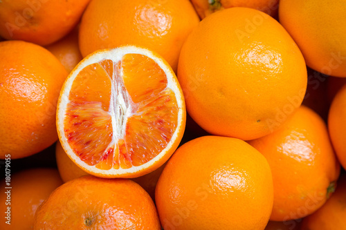 Canvas Prints Fruits Citrus fruits background. Fresh tangerines oranges on market. Group of freshly picked oranges with their leaves forming a background. Top view of slices, whole of orange fruits and leaves close up.