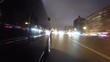 Fast city drive night road POV through city at night timelapse left side of car. Low angle view. Camera shoots back