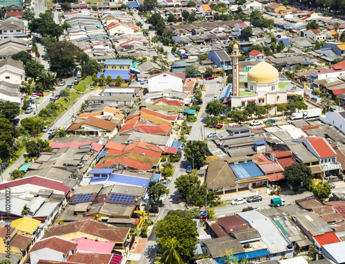 Aerial view of mosque surrounded by colourful neighbourhood in suburb of Kuala L Poster