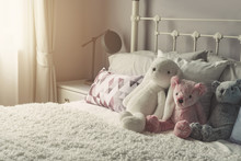 Group Of Teddy Bear On Bed Wit...