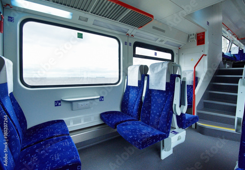 Emtpy interior of the intercity double decker train of comfort class ...