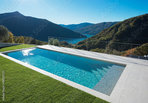 Modern swimming pool with lake and valley view Fototapeta