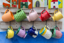 Colorful Empty Cups Hanging On...