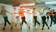 men and ladies dancing aerobics at lesson