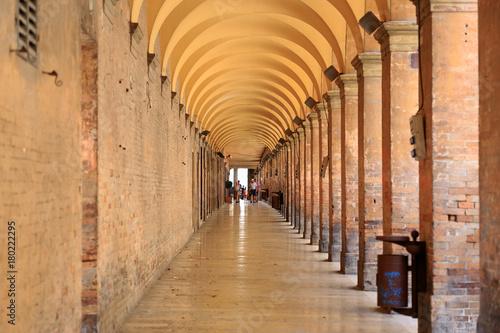 Fotografia, Obraz  Urbino, Italy - August 9, 2017: Pedestrian zone near the building under an arch