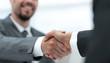 closeup .handshake of business partners on a Desk