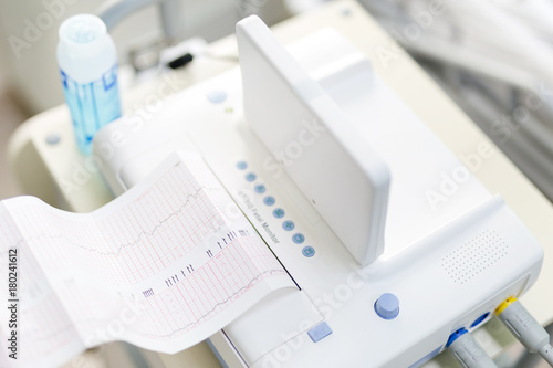 Cardiotocograph device  in a hospital  to examine  fetus heartbeat and make card Fototapeta
