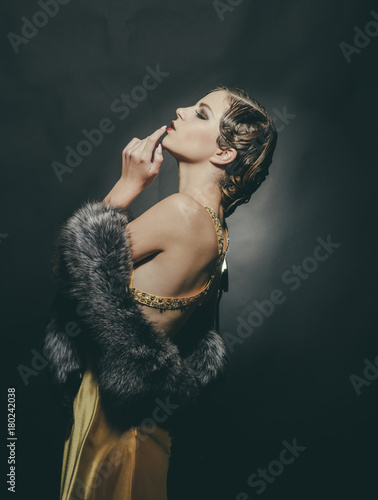 Photo  Girl in fashionable yellow dress and fur.
