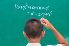 Students Stand In Front Of Green Chalk Board At The Classroom. He Doubts The Mathematical Equation And Exponent That The Teacher Answers. Education Background Concept.