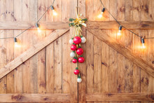 Christmas Decoration On Old Grunge Wooden Board. Warm Gold Garland Lights