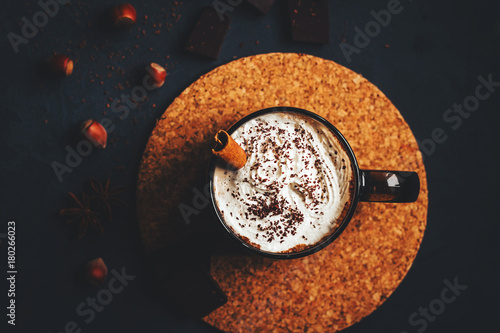 Spoed Foto op Canvas Chocolade hot chocolate with cream in a dark mug on a black background
