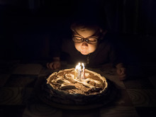 Little Boy Blows Out Candles O...