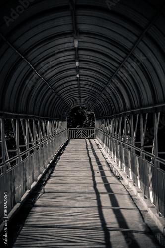 Papiers peints Tunnel inside of modern metal structure bridge or overpass walk way
