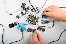 Man Connecting Different Electrical Boards