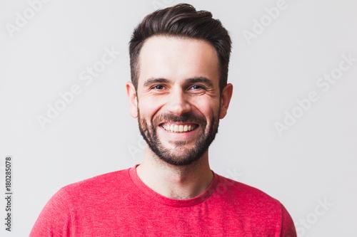 Fotografie, Obraz  Portrait of a handsome young man smiling