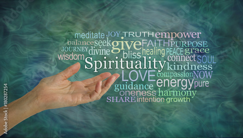 Valokuva  The meaning of Spirituality Word Cloud - female open palm hand gesturing towards