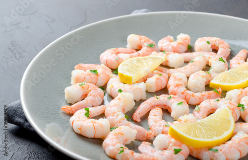 Fotobehang Schaaldieren Roasted peeled prawns in a garlic and ginger sauce with herbs an