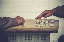 Hands Of Two Men Playing Chine...