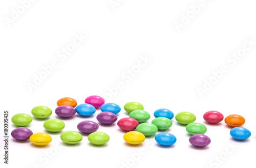 Poster Confiserie The multi-color candies on the white background