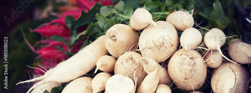 White radishes pile in a market