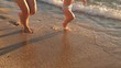 Young Mother and Her Son Walking on the Beach. Slow motion.