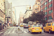 Citylife and traffic on Manhattan's avenue, New York City, United States. Toned image