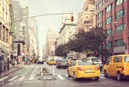 Photo sur Toile New York TAXI Citylife and traffic on Manhattan's avenue, New York City, United States. Toned image