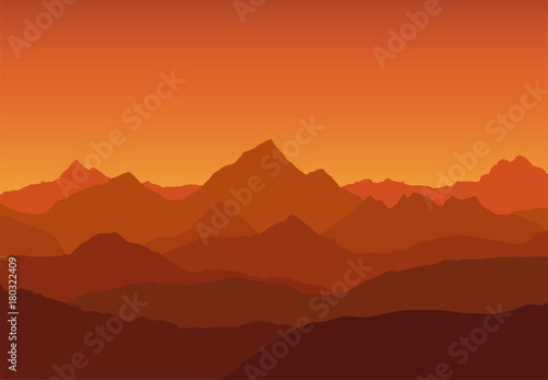 Spoed Foto op Canvas Bruin panoramic view of the mountain landscape with fog in the valley below with the alpenglow orange sky