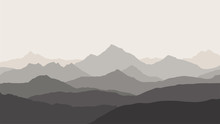 Panoramic View Of The Mountain Landscape With Fog In The Valley Below With The Alpenglow Grey Sky