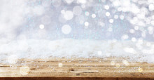 Christmas Snowy Bokeh Background Over Wooden Surface