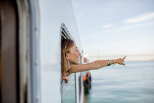 Young Woman Traveler Pulling O...