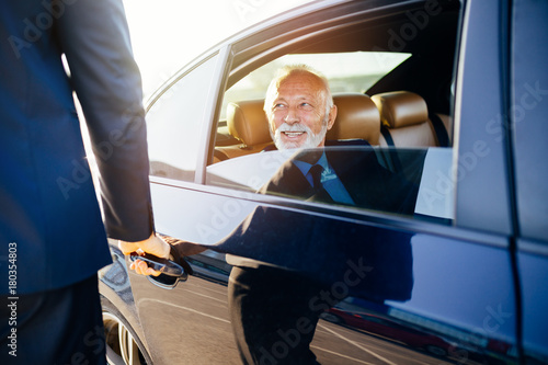 Senior business man sitting in his limousine Tableau sur Toile