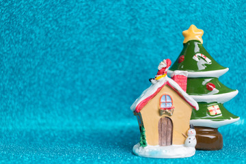 House and Pine tree on sparkling background.  Christmas seasons celebration concept