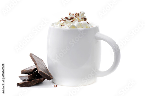 cup of hot chocolate with chocolate pieces on white background