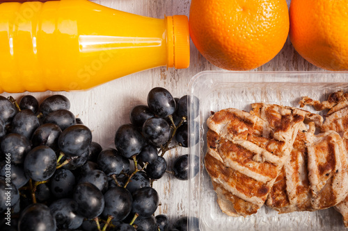 Healthy Lunch Of Grilled Chicken Cabbage Grape And Juice Packed In