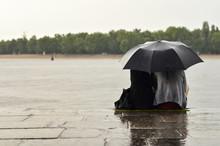 Lovers Sitting On Quay Under U...