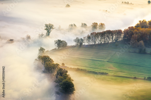 Photo View of the Adda river valley during a foggy morning, Airuno, Italy