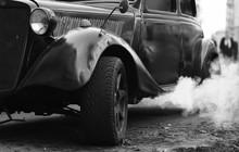 The Retro Car Smokes In The Ci...
