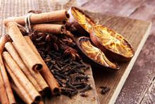 Dry Orange Slices, Cinnamon Sticks, Anise And Clove Christmas Spices Decoration.
