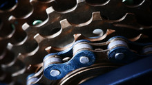 Close Up On Greasy Bicycle Chain And Rear Cassette