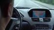 Inside a car. A GPS module is on. Close-up shot