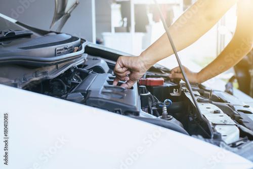 Mechanic changing oil mechanic car with open hood Wallpaper Mural