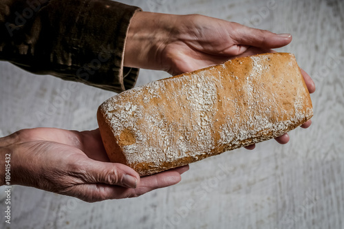 Foto op Plexiglas Brood Baked bread in woman hands