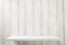 White Shelf On Wooden Wall Background