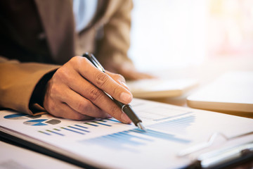 Business Financing Accounting Banking Concept, businesswoman doing finances and calculate about cost to real estate investment and in other, tax system
